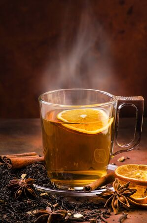 cup of steaming black tea flavored with cinnamon and spices