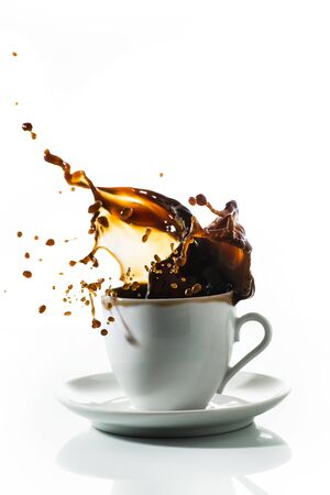 coffee cup with splash on the white background Stock Photo