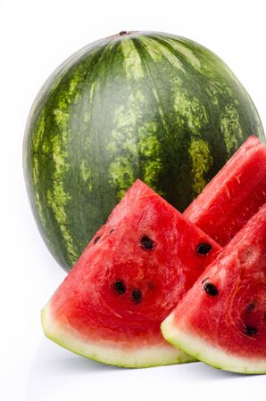 fresh, whole and sliced watermelon isolated from the white background