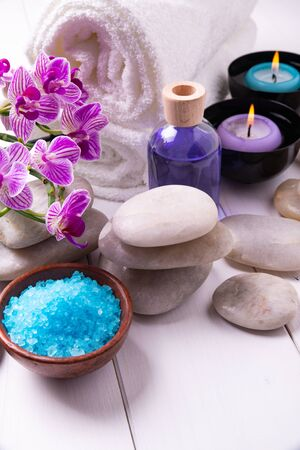 composition of the spa treatment. Candles in bowls with water, bath salts, and orchid flowers. Stock fotó