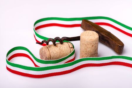 in the foreground, corks of Italian wine, and a tricolor ribbon 스톡 콘텐츠