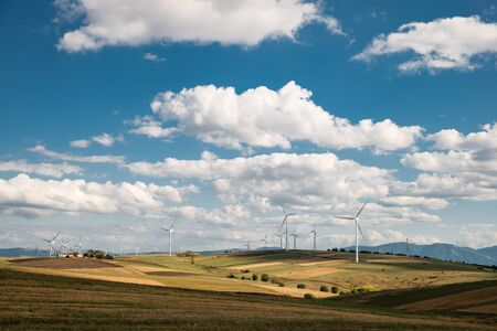 solar countryside landscape with wind generators