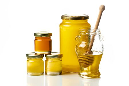 some types of honey in glass jars isolated from the white background