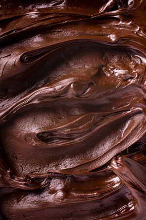 background of melted chocolate in the foreground with top view