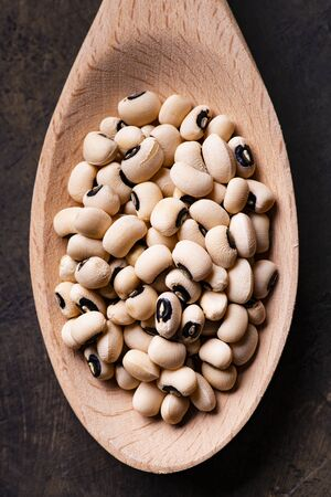 View from above, in the foreground, a spoonful of beans with the eye, a typical Italian legume of ancient tradition.
