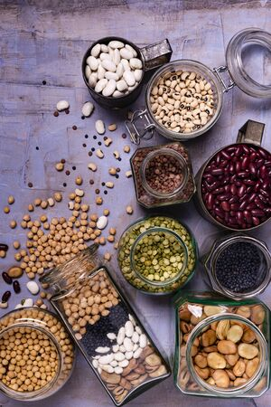 large variety of dried legumes in glass jars. background texture with top view Zdjęcie Seryjne