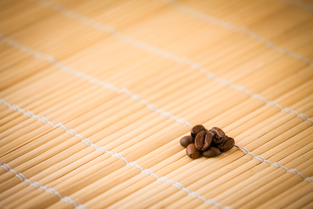 coffeebeans: Coffee-beans on bamboo Stock Photo