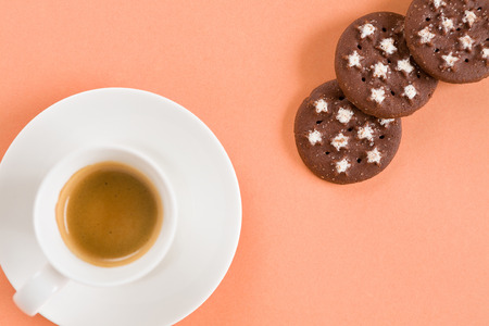 expressed: Italian coffee and biscuits on pink background seen from above Stock Photo