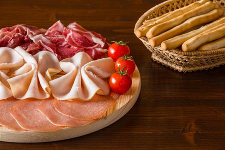 Italian cutting board and bread-sticks on a wicker basket