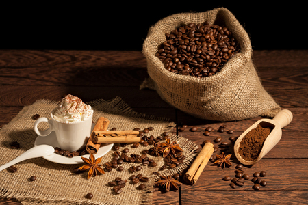 Coffee with whipped cream, cocoa powder, cinnamon and star anise