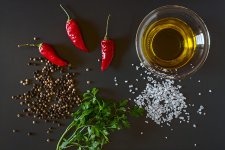 Fresh chili, parsley, oil, salt and pepper seen from above