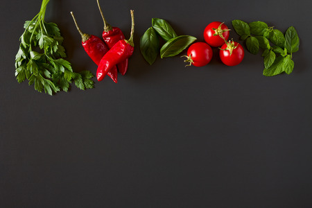 Red and green raw vegetables seen from above
