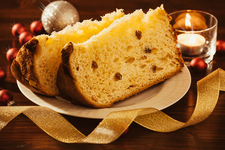 Closeup of sliced italian panettone with decorations