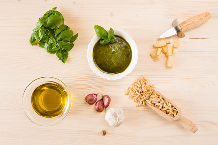 Pesto genovese sauce with its ingredients seen from above Archivio Fotografico