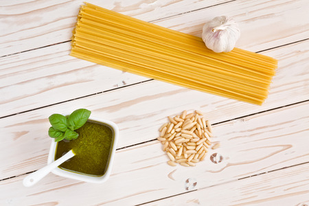 Pesto genovese and linguine pasta, pine nuts and garlic seen from above