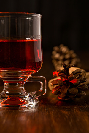 alcoholic drink: Closeup of alcoholic punch drink and pine cone