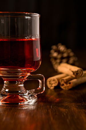 alcoholic drink: Closeup of alcoholic punch drink and cinnamon sticks on background