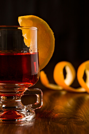 alcoholic drink: Closeup of alcoholic punch drink and sliced orange fruit