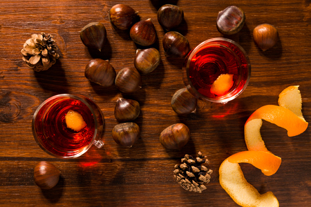 alcoholic drink: Alcoholic punch drink, chestnuts and pine cone seen from above