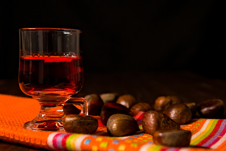 alcoholic drink: Alcoholic punch drink and chestnuts over a colored napkin