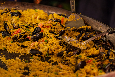 spice: Large pan of seafood paella in a street tray
