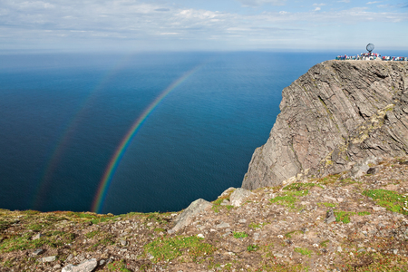 Double rainbow from the cliff of North Cape in Mageroya island, the most northerly point of Europe, Norway