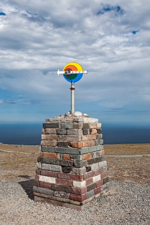 The arrow sign in North Cape in Mageroya island showing the north direction, Norway Stock Photo