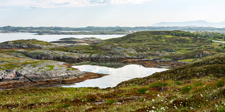 Panorama of the mountain and ocean from the Atlantic road in Hulvagen, Norway Stock Photo