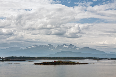 Panoramic mountain view with a house in an island in the fjord in Molde, Norway