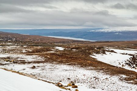 High panoramic view of the Lagarfljot river and mountains in a winter day, Iceland Stock Photo