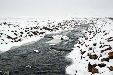 River before Snaedufoss waterfall near Laugarfell, Iceland