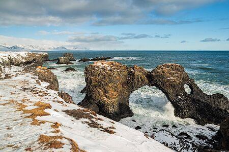 Gatklettur arch in the ocean in Arnarstapi village, Iceland Stock Photo