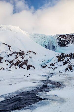 Iced Svodufoss waterfall in Snaefellsnes peninsula, Iceland