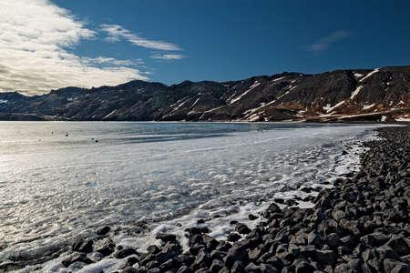 Kleifarvatn lake in winter in a sunny day near Krysuvik sulfuric area in Reykjanes peninsula, Iceland Stock Photo