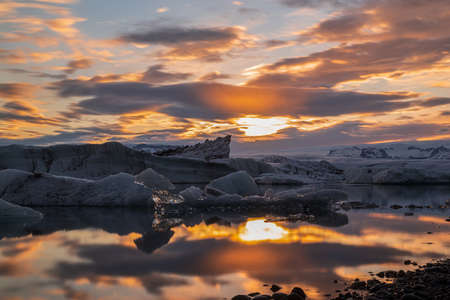 Colorful sunset in Jokulsarlon glacier lagoon in Vatnajokull National Park, Iceland
