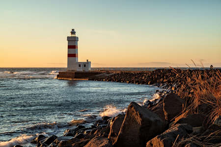 The Gardur lighthouse at sunset in Iceland Stock Photo