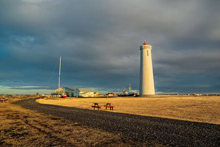 Gardur lighthouse and old ships at sunset, Iceland