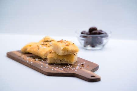 Italian focaccia with onion over a cutting board Stock Photo