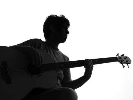 re do: Silhouette from a woman and a guitar