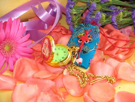 Ribbons, clock, make up and chinese characters