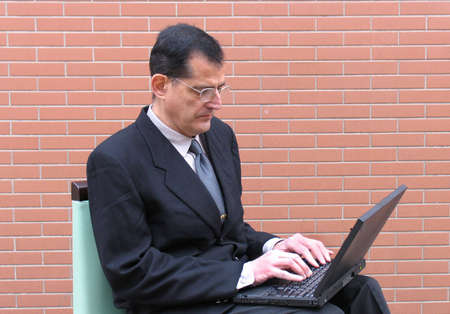 A businessman working on his laptop