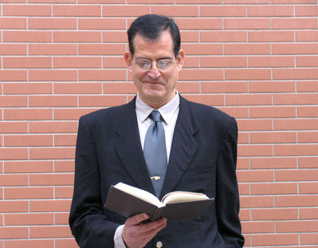 Outstanding businessman reading a book