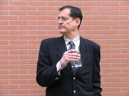 Outstanding businessman drinking water