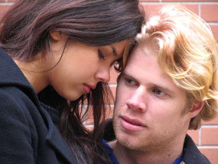 Loving couple, european guy and latin girl Stock Photo