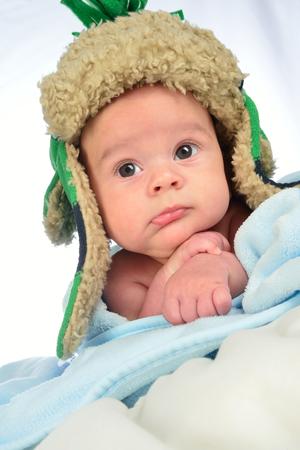newborn close up looking at camera.