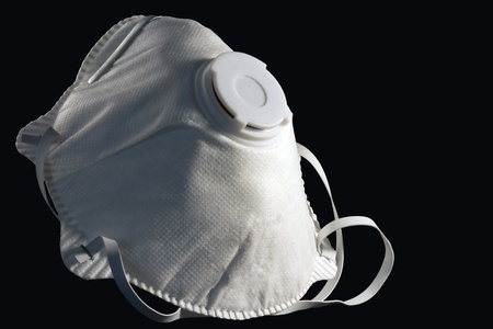 safety mask on a black background photo