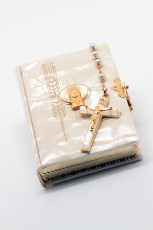 book and the first communion rosary photo