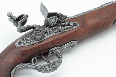 detail in the foreground of the hammer and trigger of an old pirate pistol photo