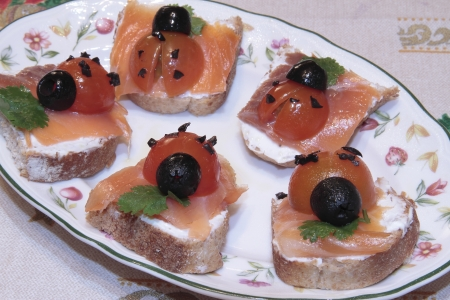 Photographs of some  canapes having  shaped ladybug photo