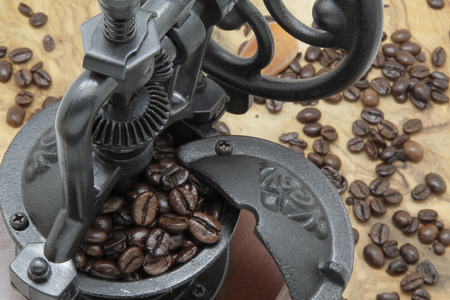 decaffeinated: coffee grinder with some coffee beans Stock Photo